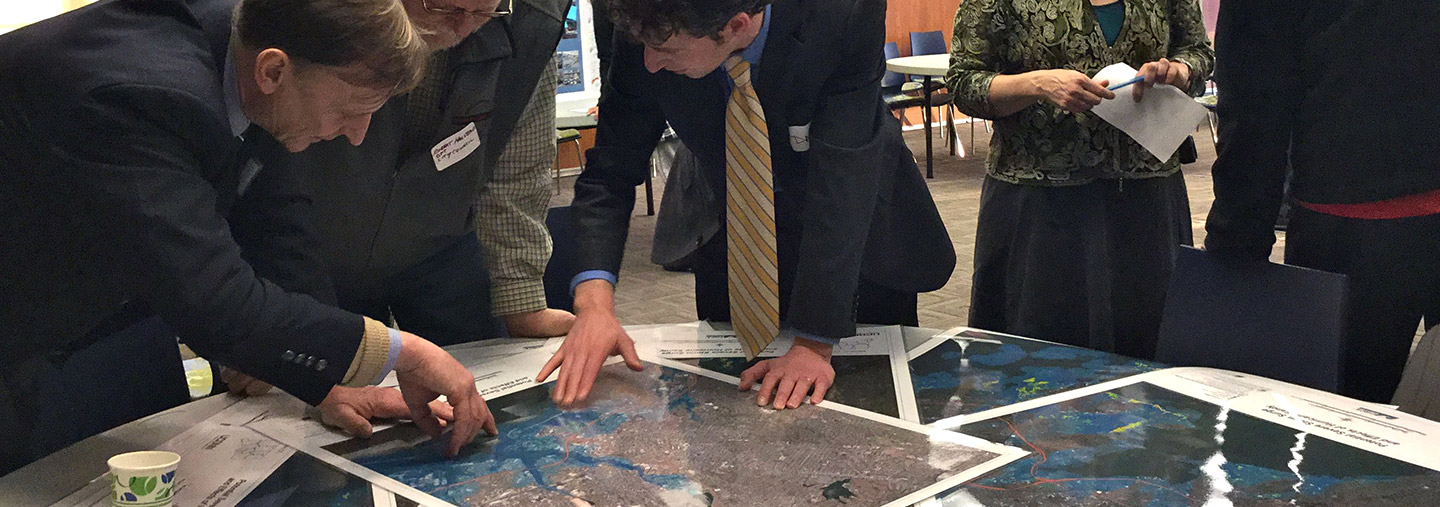 people reviewing maps